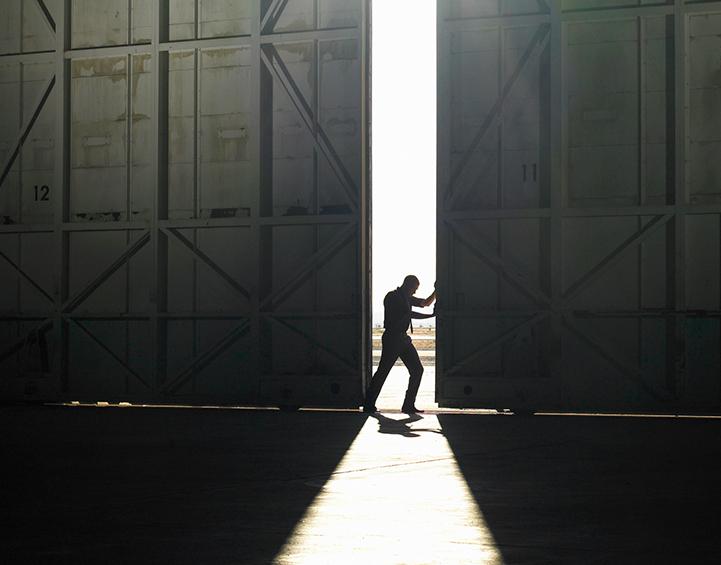 Man opening doors